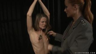 Katy Parker puts clampls on nipples of Lillandra Thumbnail