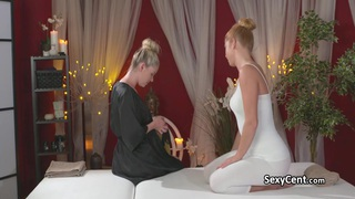 Redhead lesbian fucked on massage table Thumbnail
