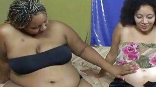 Pregnant black lesbo gets dildo in shaved pussy