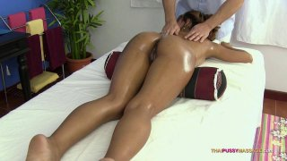 Cute Asian babe gets her tied cunt oiled and massaged Thumbnail