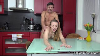 Steamy sex in the kitchen between young babe Dana Thumbnail